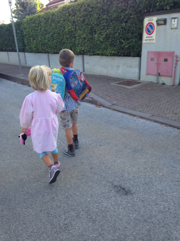 Two cutie pies on their first day of school. Sweet brother carrying his sister's backpack. A little southern gentleman in the making.